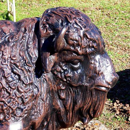 Baby buffalo metal statue closeup