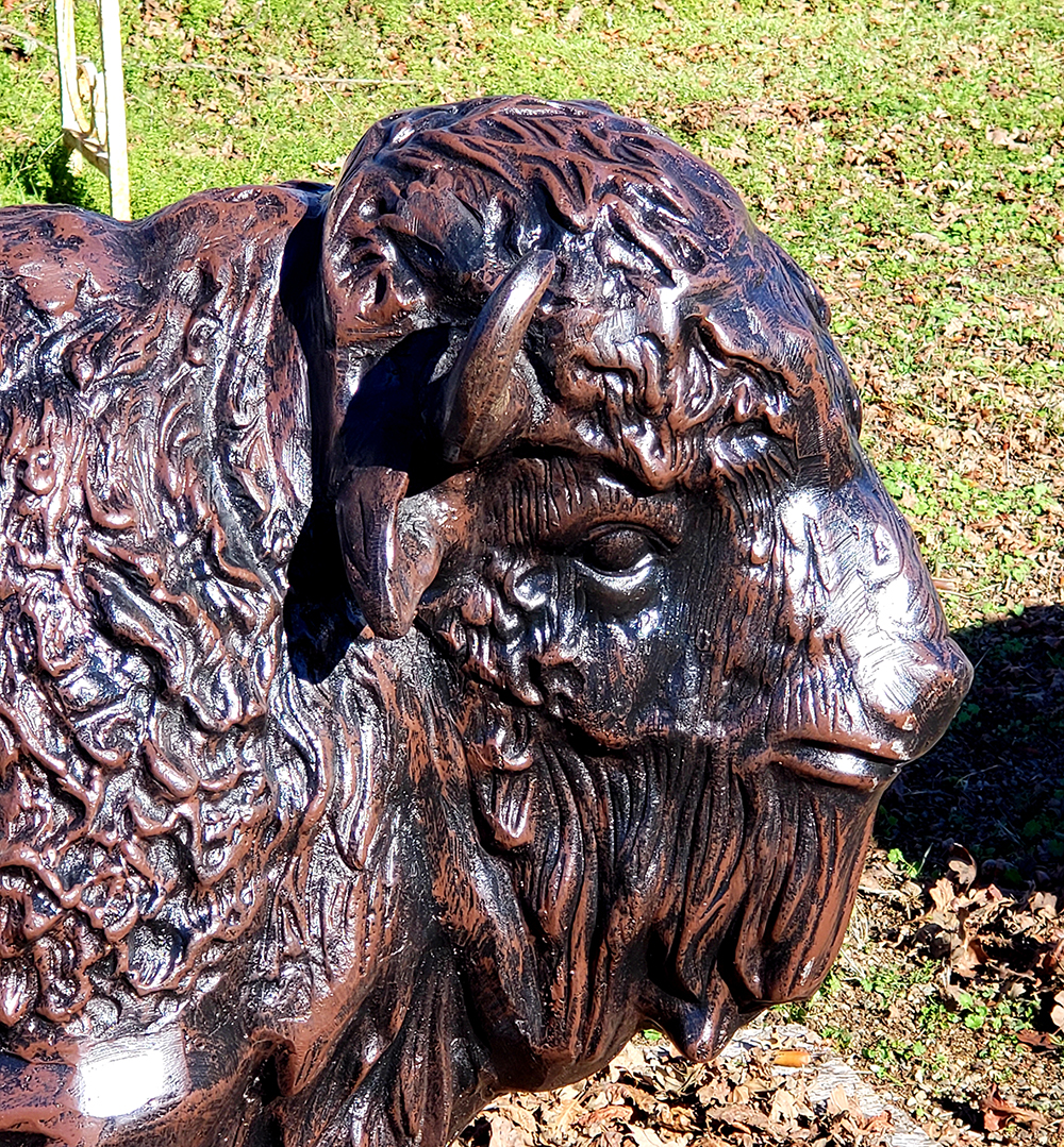 Baby buffalo metal statue closeup