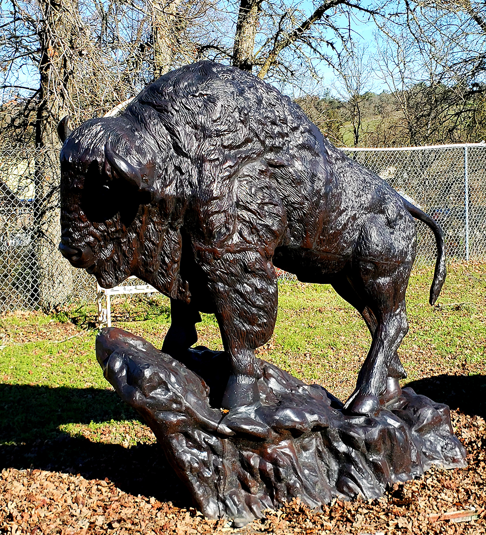 Buffalo statue on rock front view