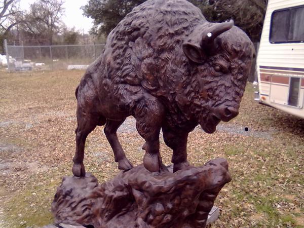 cast-aluminum-buffalo-on-a-rock