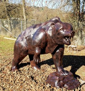 Grizzly Bear Statue on Rock