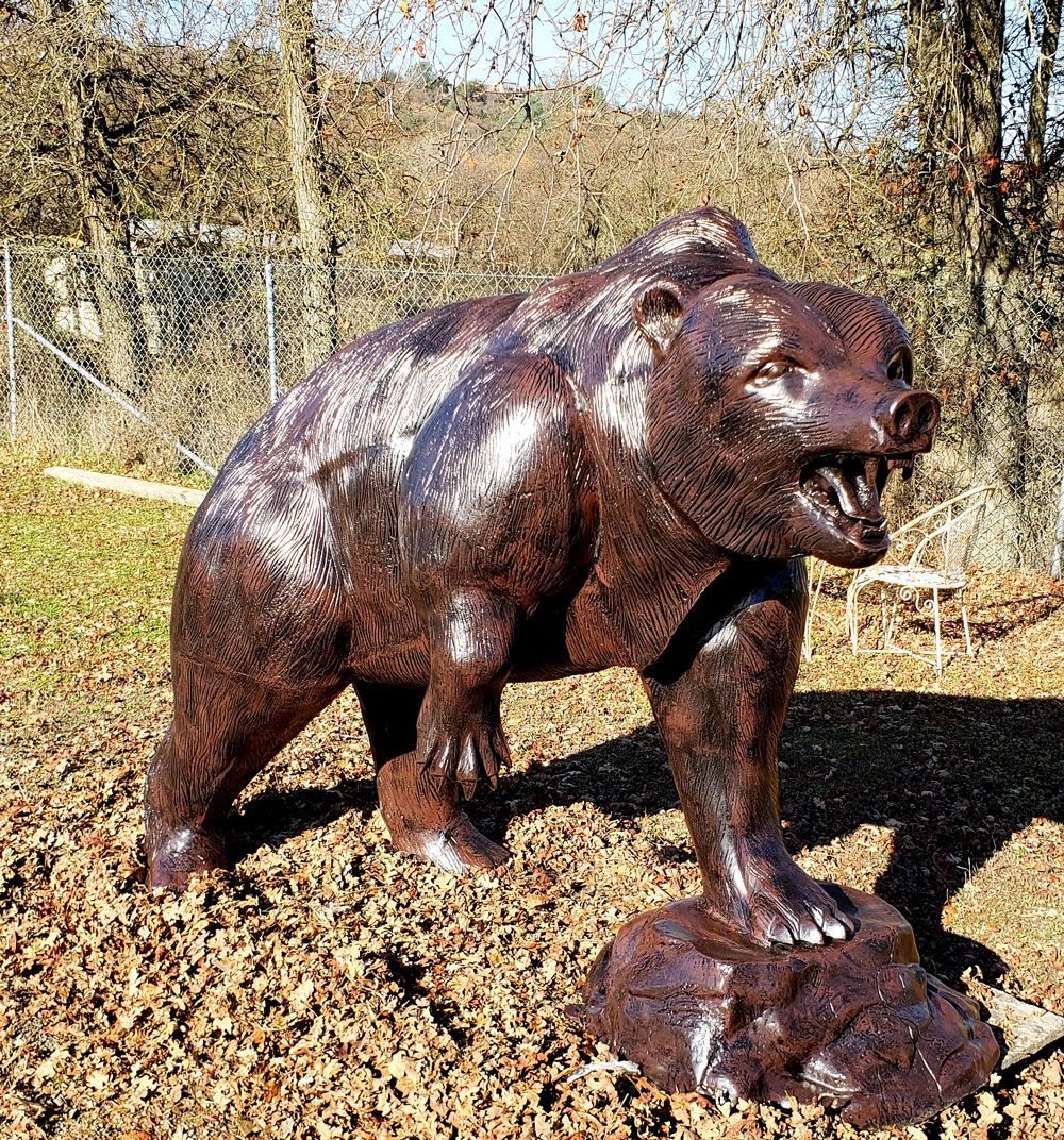 metal-bear-statue-on-rock-roaring