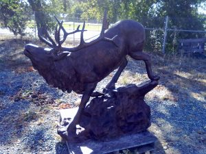 Medium Elk Climbing Down on Rock Lawn and Garden Statue