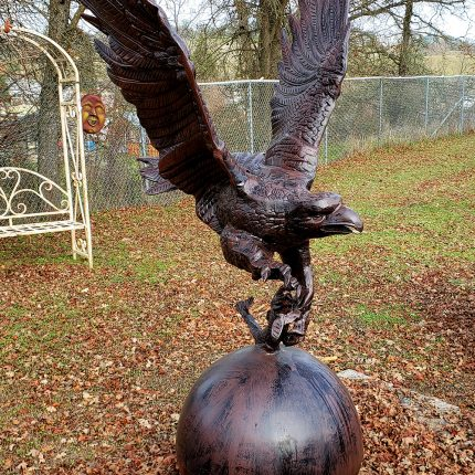 Metal Eagle Statue On Ball Catching Fish