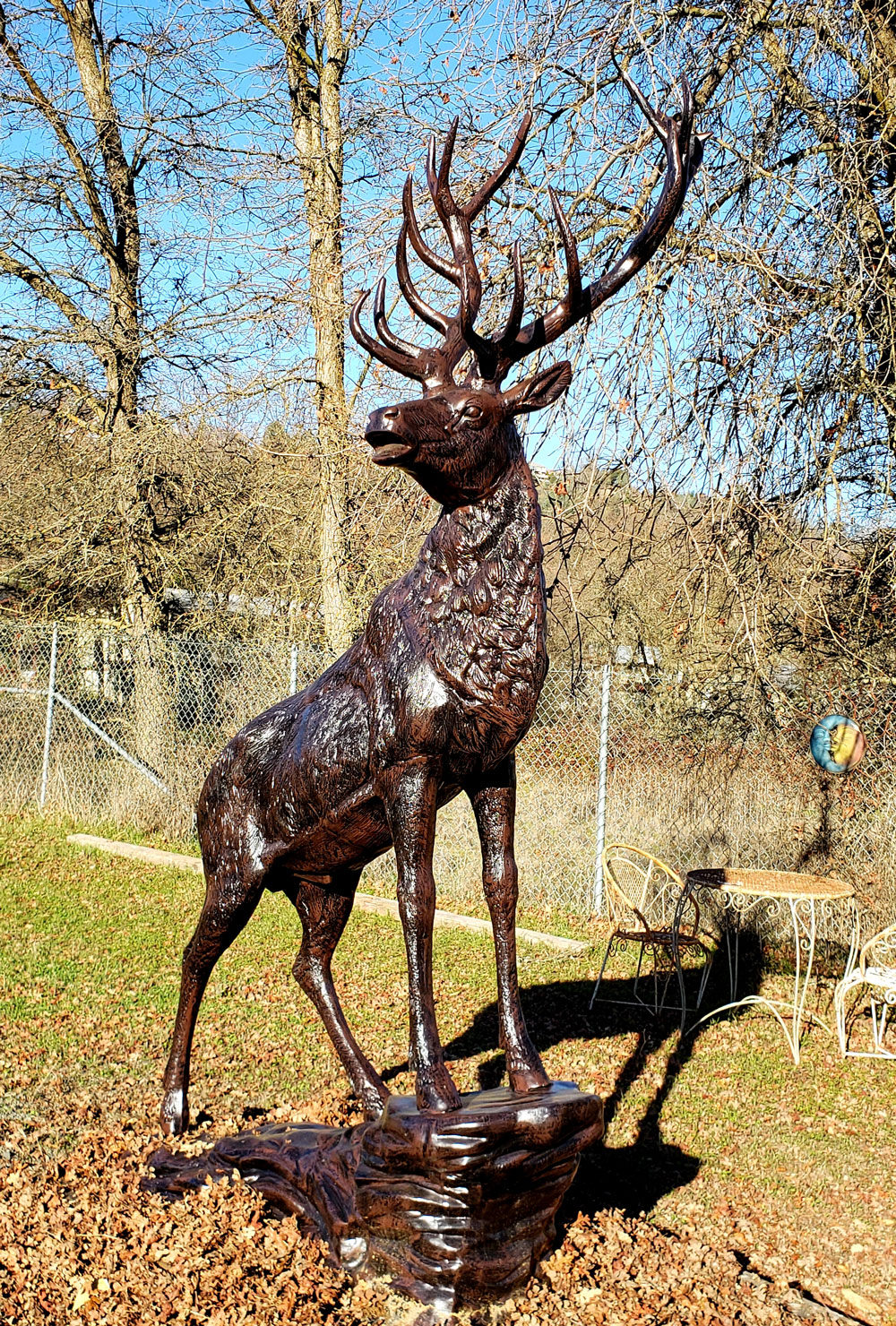 Elk Metal Statue Looking Right on Rock Front View